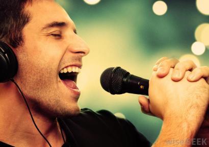 singer-holds-microphone.jpg